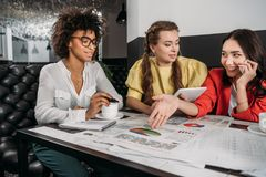 group of young businesswomen doing stock images