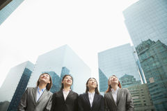 Group of young businesswomen standing in a row among skyscrapers, Beijing Royalty Free Stock Photography