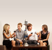 A group of young Caucasian persons smoking hookah Stock Images