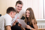 Group of young, cheerful partners in business Stock Photos