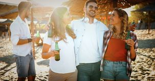 Group of young cheerful people bonding to each other and smiling. Carefree weekend with friends. Group of young cheerful people bonding to each other and smiling royalty free stock photos