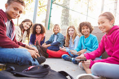 Group Of Young Children Hanging Out In Playground royalty free stock photo