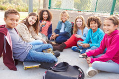Group Of Young Children Hanging Out In Playground stock images