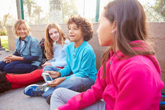 Group Of Young Children Hanging Out In Playground Royalty Free Stock Image