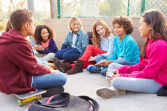 Group Of Young Children Hanging Out In Playground Royalty Free Stock Photos