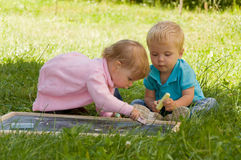 Group of young children spending time in nature. Stock Photos