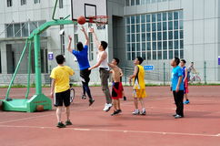Pengzhou, China: Men Playing Basketball Royalty Free Stock Photography