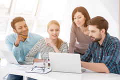 Group of young colleagues having meeting at office stock photography