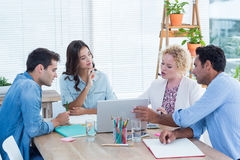 Group of young colleagues using laptop in a meeting Stock Photography