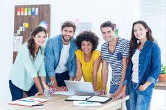 Group of young colleagues using laptop Stock Photo
