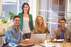 Group of young colleagues using laptop Royalty Free Stock Photography