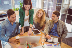 Group of young colleagues using laptop Royalty Free Stock Images
