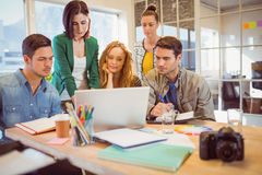 Group of young colleagues using laptop Stock Photos
