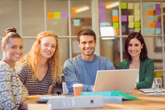 Group of young colleagues using laptop Royalty Free Stock Image