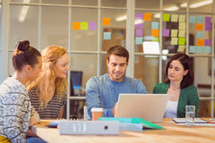 Group of young colleagues using laptop Stock Images