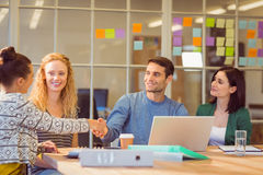 Group of young colleagues using laptop Royalty Free Stock Photos