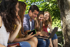 Group of young college students. At park Stock Photo