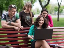 Group of young college students using laptop Royalty Free Stock Photography