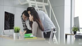 Group young coworkers together discussing creative project during work process modern colleagues in smart casual wear working. stock video