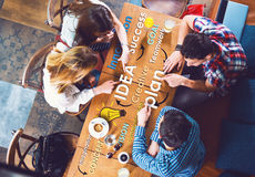 Group of young and creative people at the table, talking stock image