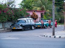 A group of young Cubans in a street in Varadero. A group of young Cubans in a street next to restored American cars on the beach of Varadero. Cuba Stock Photos