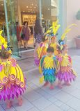 A group of children  dancers dressed in Spanish style represent  Spanish cultural heritage. A group of young dancers are dressed in yellow, golden/ blue amd pink Royalty Free Stock Photography