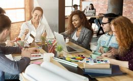 Group of young designers working with project royalty free stock photo