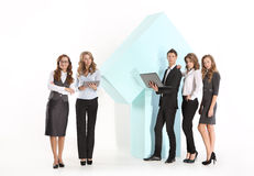 Group of young employees at a large arrow Royalty Free Stock Images