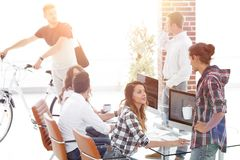 Group of young employees in a modern office Royalty Free Stock Photography