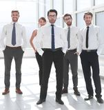 Group of young employees standing in the office. The concept of professionalism royalty free stock photos