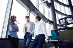 Group of young entrepreneurs are looking for a business solution during work process at office.Business people meeting royalty free stock photography