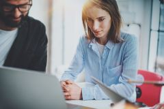Group of young entrepreneurs working time at sunny office.Business people meeting concept.Blurred background.Horizontal. stock images