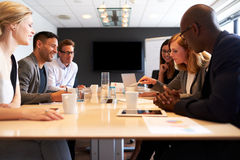 Group of young executives having a meeting stock images
