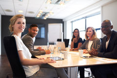 Group of young executives smiling at camera. During a work meeting royalty free stock photos