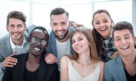 Group of young executives smiling at camera during a work meeting. royalty free stock photography