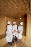 Girls relaxing in sauna royalty free stock photography