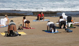 Group of young females practicing yoga on the seaside. Group of young people have meditation on yoga class,Tenerife,Spain stock photo