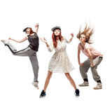 Group of young femanle hip hop dancers on white background Royalty Free Stock Photos