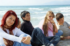 Group of young friends on the beach Stock Image