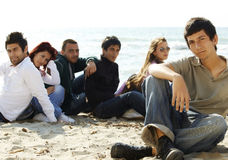 Group of young friends on the beach Stock Images