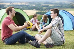 Group Of Young Friends Camping In the Countryside Royalty Free Stock Photography