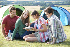 Group Of Young Friends Camping In Countryside Reading Map Royalty Free Stock Photography