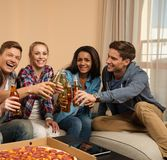 Group of young friends celebrating in home interior Royalty Free Stock Photos