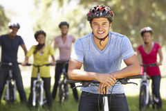 Group Of Young Friends On Cycle Ride In Countryside Royalty Free Stock Photos