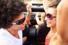 Group Of Young Friends Dancing In Back Of Open Top Car Royalty Free Stock Images