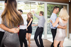 Group of young friends dancing. At the party stock photography