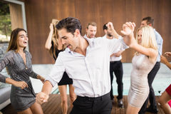 Group of young friends dancing. At the party royalty free stock photos