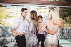 Group of young friends dancing. At the party royalty free stock images