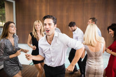 Group of young friends dancing stock photography