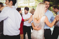 Group of young friends dancing. At the party stock image